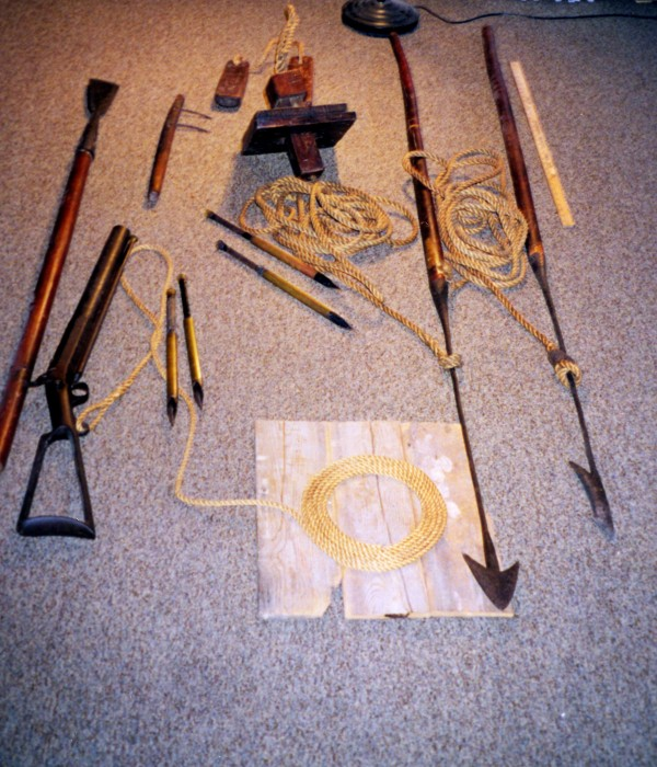 Whaling tools including harpoon and bomb gun.