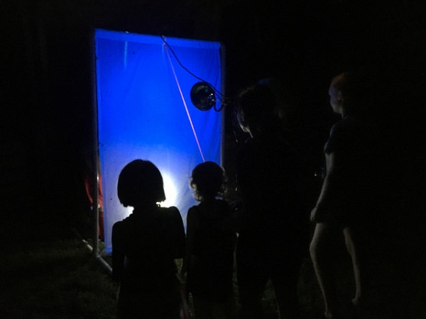 visitors checking out moths at one of the blacklights