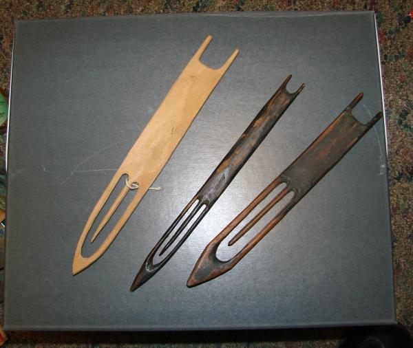 three long, thin wooden items