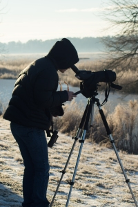 birder with spotting scope